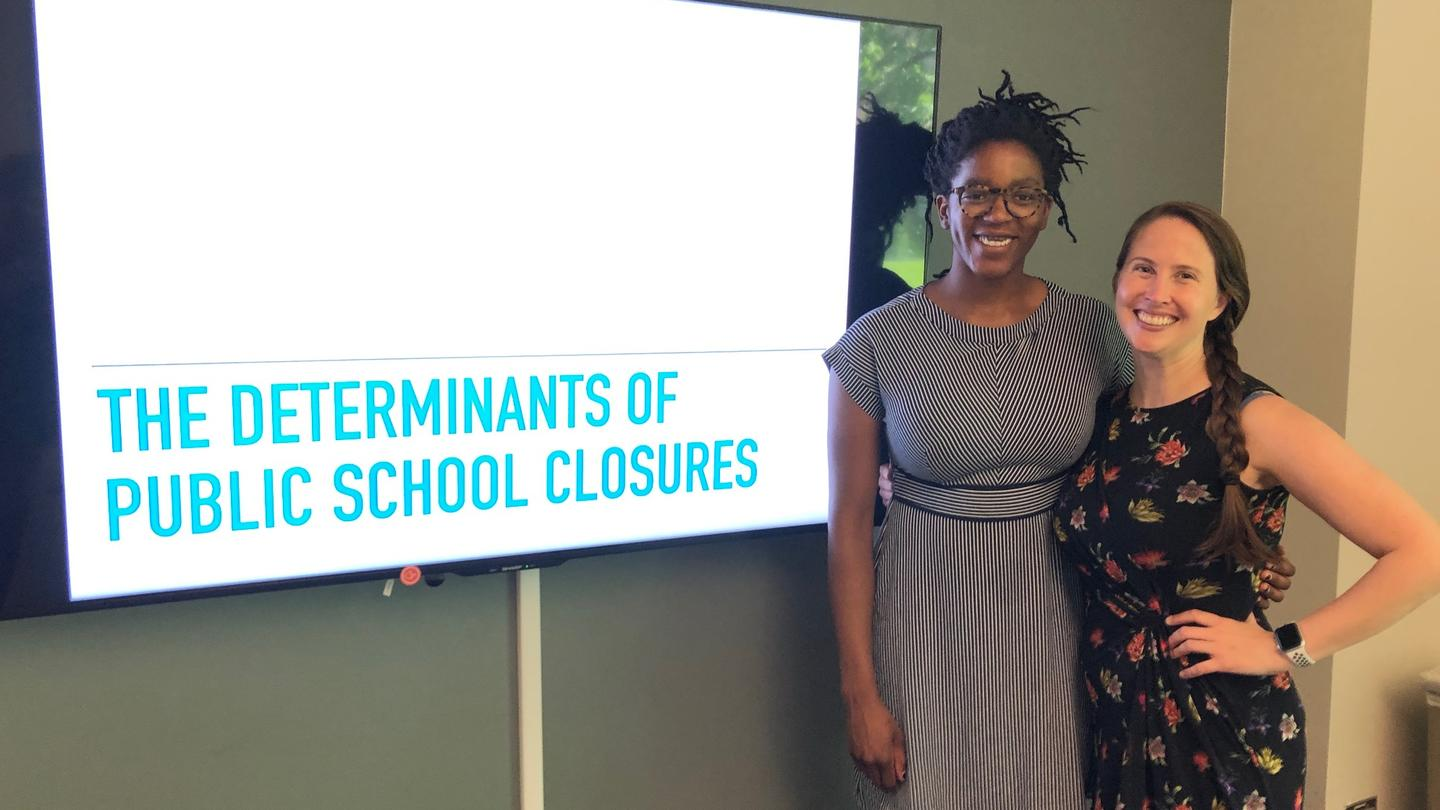 Jennifer Jennings standing with Keren Kabambi '19 and their presentation title.
